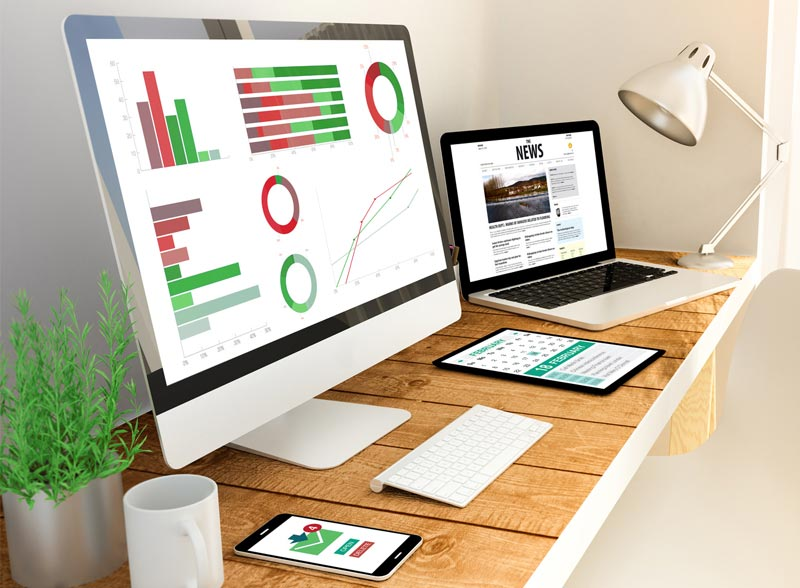 Office desk with computer screen showing data